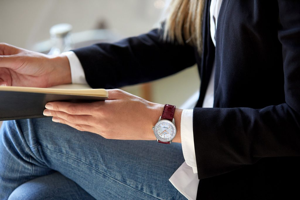 17 Female Model Wearing The Navitimer Automatic 35 With A White Mother Of Pearl Dial With Diamond Hour Markers And A Burgundy Alligator Leather Strap 1 1024x683